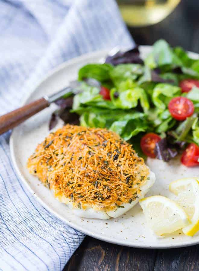 Mild tasting cod encased in a flavorful, crispy crust, this baked cod with lemon and parmesan is a simple and delicious way to add healthy seafood to your weekday menu. High in protein and low in fat, inexpensive cod is a great choice.