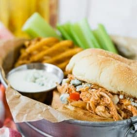 This crockpot buffalo chicken is made in the crockpot and becomes so tender and flavorful as it cooks. It's perfect on sandwiches or sliders!