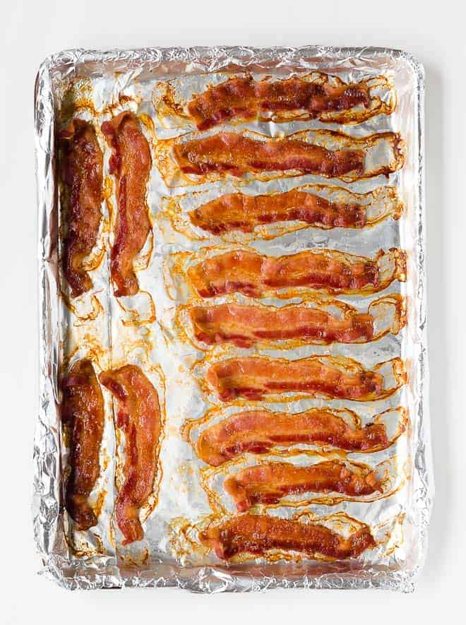 Image of crispy bacon that has been baked on a sheet pan.