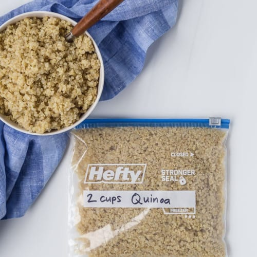 Cooked quinoa, in a bowl and in a quart size freezer bag labeled and dated.