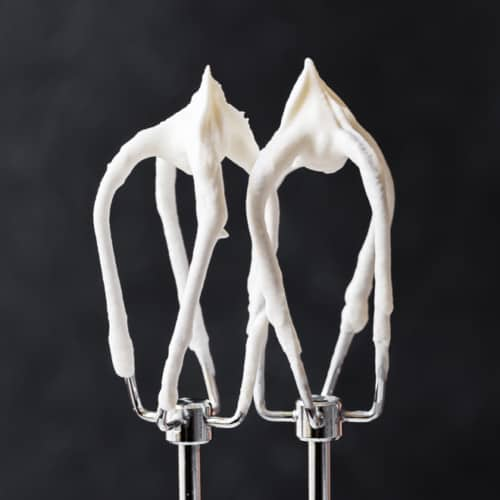 Image of homemade whipped cream on beaters.
