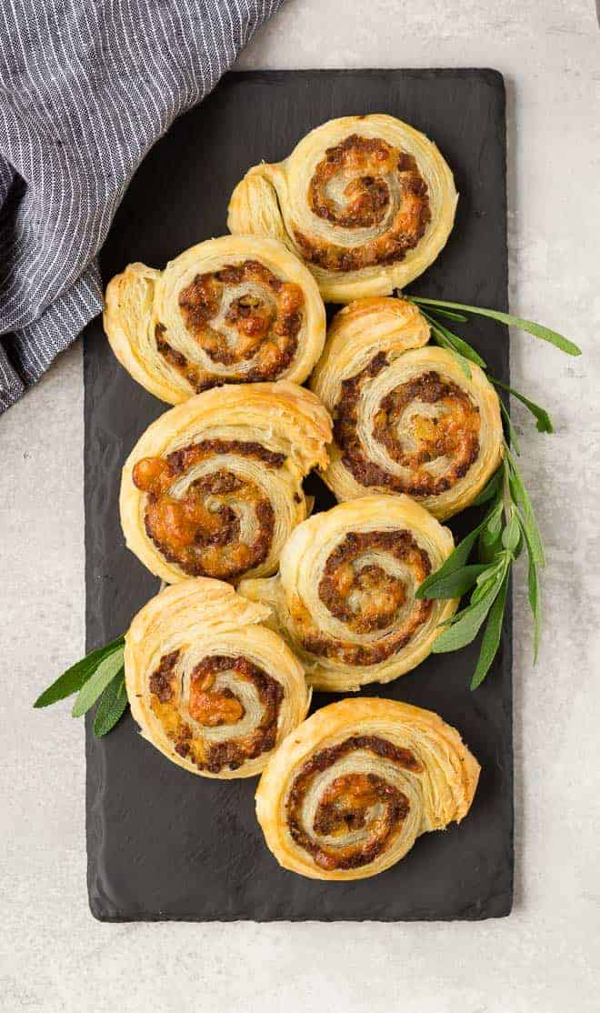 Sausage puff pastry wheels made with apple and gruyere, overhead view.