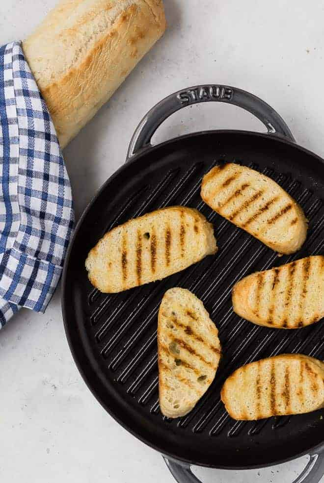 Image of bread toasted in a grill pan to make crostini.