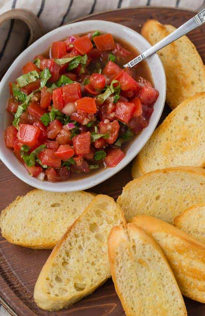 A classic Italian appetizer made with fresh tomatoes, garlic, and basil, this tomato bruschetta recipe is bright and delicious, and super easy to make! You'll love it!