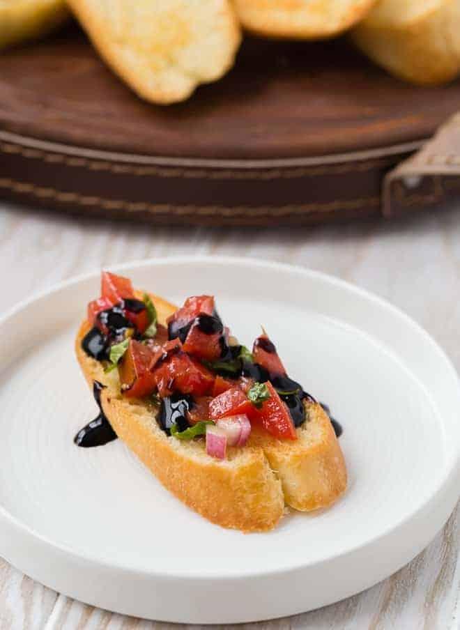 Photograph of bruschetta pomodoro served on crostini.