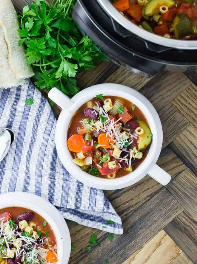 Image of vegetarian minestrone soup with carrots, zucchini, celery, kidney beans, pasta and more!