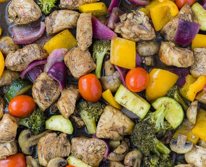 image of vegetables and chicken on a sheet pan, close up