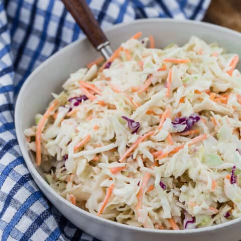 Simple, easy, creamy coleslaw in a white bowl.