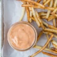Image of french fries with delicious light-orange fry sauce made with mayonnaise, ketchup, mustard, relish, and apple cider vinegar.