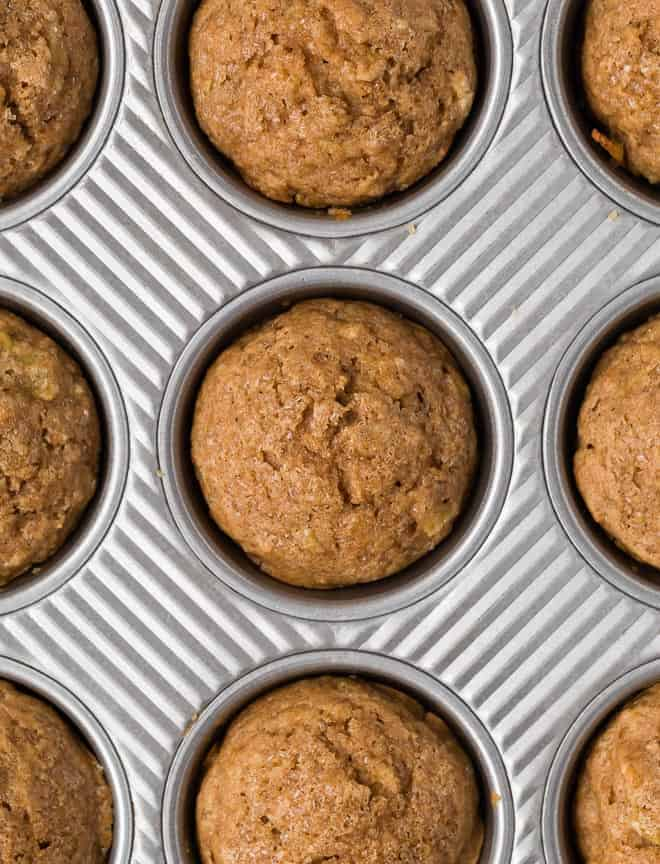 Overhead view of apple cinnamon muffins in a muffin tin.