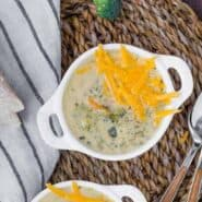 Image of pressure cooker broccoli cheddar soup in white bowls.