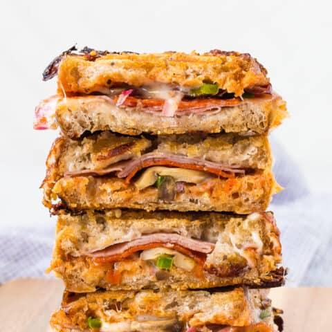 Stack of pizza panini sandwiches.