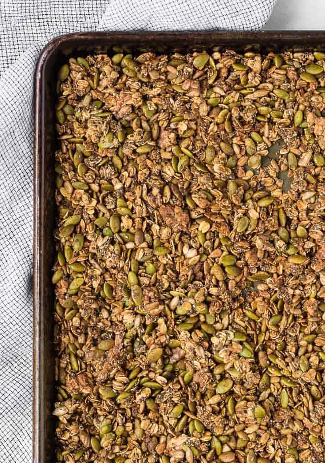 Image of savory granola on a large sheet pan.