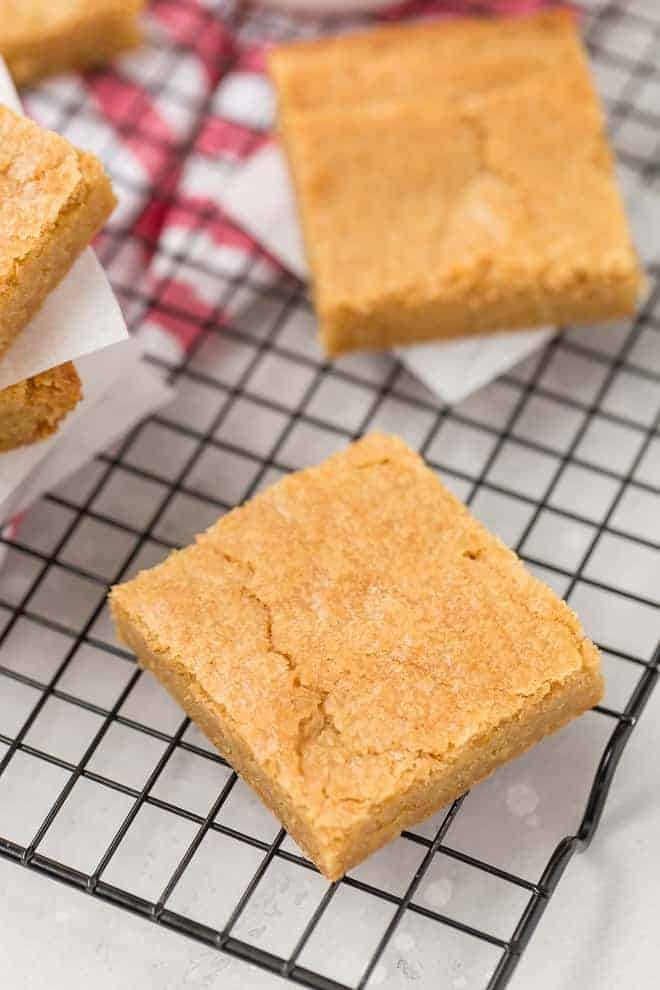 Image of blondies on a cooling rack.