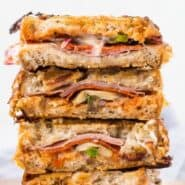 Sautéed mushrooms, peppers, and onions, layered with pizza sauce, ham and pepperoni, and oozing with melted mozzarella cheese, this grilled pizza panini is ridiculously good.