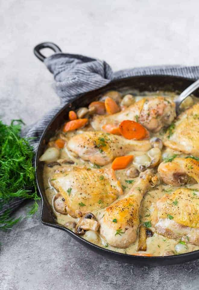 Image of dark meat chicken pieces in creamy lemon dill sauce.
