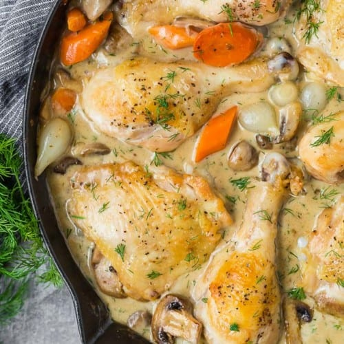 Image of chicken fricassee in a black skillet.