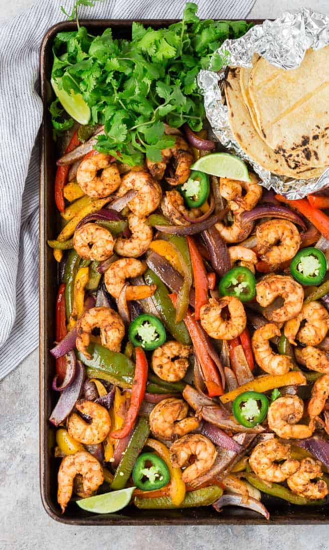 Shrimp fajitas on a sheet pan.