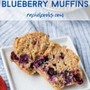 "A muffin split open on a plate, a text overlay reads ""whole wheat strawberry blueberry muffins."""