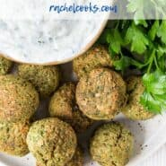 "Overhead view of falafel, tzatziki, and fresh parsley, with a text overlay that reads ""air fryer falafel, rachelcooks.com"""