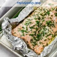"""Salmon in a foil wrap, with a text overlay that reads """"easy grilled salmon with garlic butter."""""""
