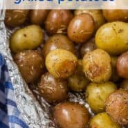 "Baby potatoes with rosemary, wrapped in foil. A text overlay reads ""super easy grilled rosemary potatoes"""