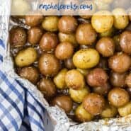 "Baby potatoes with rosemary, wrapped in foil. A text overlay reads ""easy grilled rosemary potatoes, rachelcooks.com"""