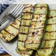 Overhead view of stacked up slices of grilled zucchini.