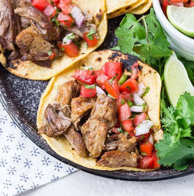 Carnitas made in an instant pot, on a corn tortilla with pico de gallo.