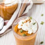 Pumpkin pudding garnished with whipped cream and pumpkin seeds.
