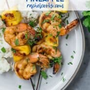 "Shrimp kabobs with pineapple. Text overlay reads ""grilled shrimp and pineapple kabobs."""