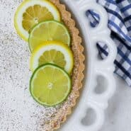 Lemon lime tart with text overlay.