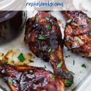 "BBQ chicken drumsticks with a text overlay that reads ""cherry chipotle bbq sauce."""