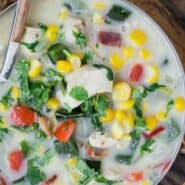 """Overhead view of creamy soup in a bowl. Text overlay reads """"chicken corn chowder"""""""