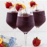 "Three glasses of a dark red frozen beverage. Text overlay reads ""frozen sangria."""