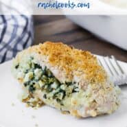 "A breaded chicken breast stuffed with spinach, feta, and onion. Text overlay reads ""spinach and feta stuffed chicken."""
