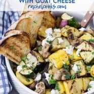 """A white bowl filled with a warm vegetable salad, text overlay rads """"grilled vegetable salad with goat cheese."""""""