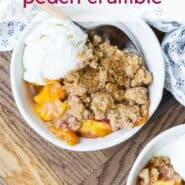 "Overhead view of plated peach dessert, with ice cream. Text overlay reads ""easy peach crumble."""