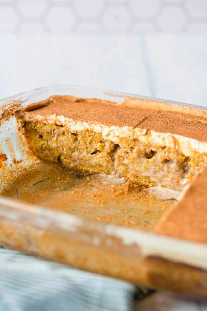 Cake in a clear baking dish, a few slices have been removed.