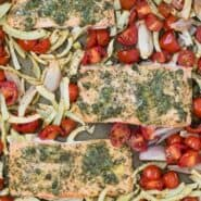 "Overhead view of sheet pan dinner with text overlay that reads ""sheet pan salmon with roasted fennel and tomatoes"""