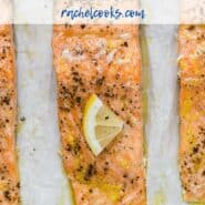"Three salmon fillets on a parchment paper lined sheet pan. Each is topped with pepper and a lemon wedge. Text overlay reads ""slow roasted lemon pepper salmon."""