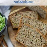 "Overhead view of sliced zucchini bread. A text overlay reads ""whole wheat zucchini bread - rachelcooks.com"""