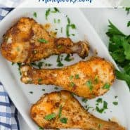 "Chicken legs on a white plate, text overlay reads ""easy air fryer chicken drumsticks - rachelcooks.com"""