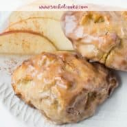 """Two baked goods on a plate with apples, text overlay reads """"air fryer apple fritters, rachelcooks.com"""""""