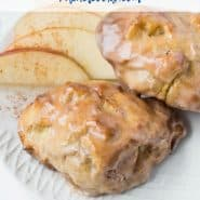 """Two apple fritters on a plate, text overlay reads """"air fryer apple fritters, rachelcooks.com"""""""