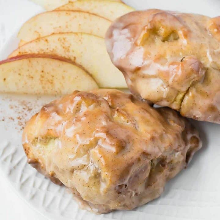 Close up of two air fryer apple fritters with a glaze.
