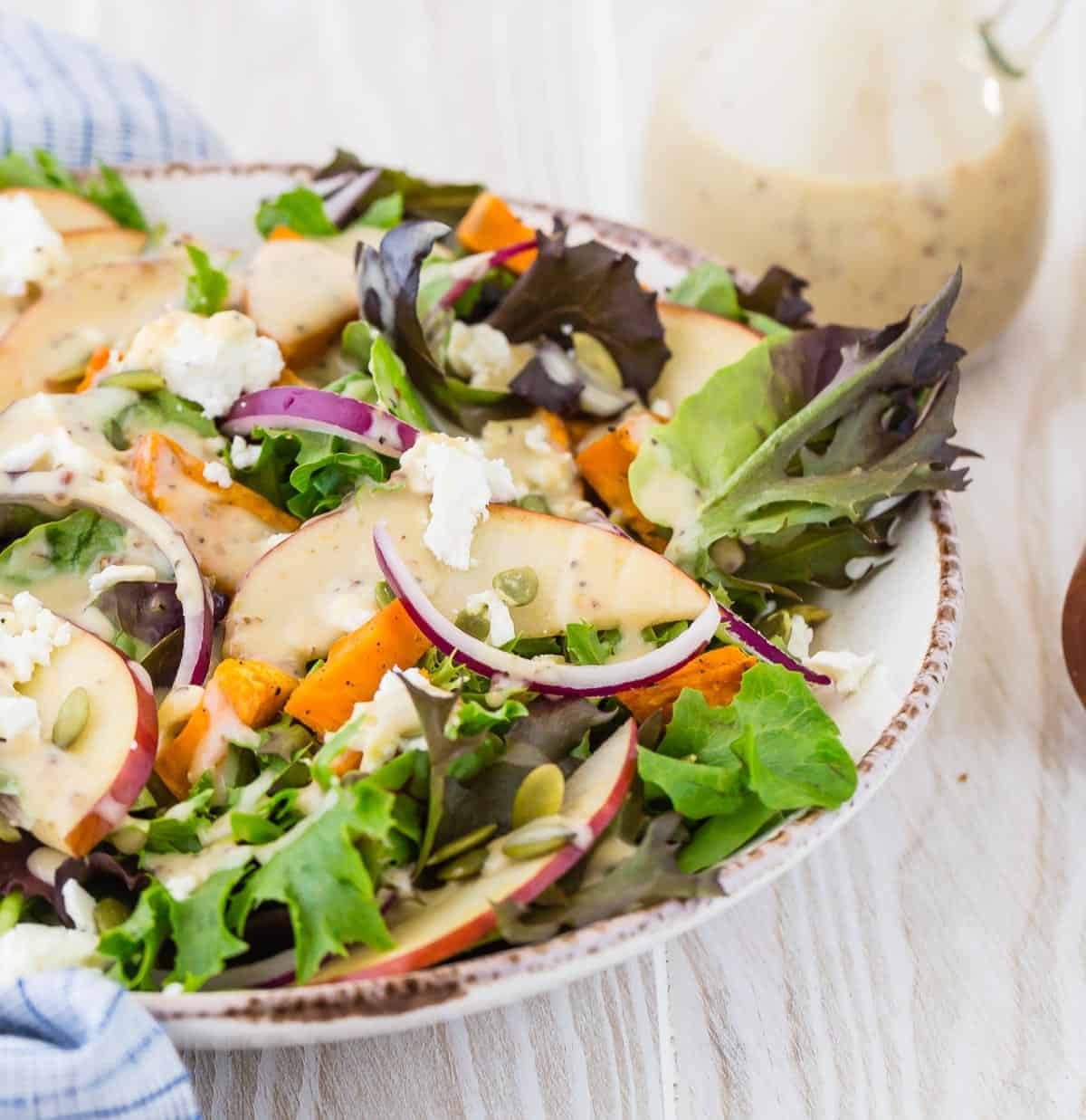 Colorful salad with creamy white dressing.