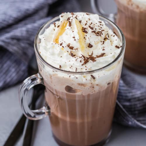 Ginger spiced hot chocolate in a mug with whipped cream and garnishes.
