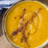 Overhead view of a bowl of kabocha squash soup.
