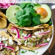 "Colorful tacos with text overlay that reads ""slow cooker pork tacos, rachelcooks.com"""